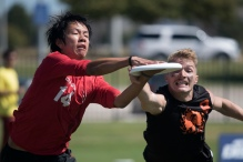 FRISCO, TX: Bob Liu (Machine #14) and JD Hastings (Ring of Fire #9) in Men's Quarters - USA Ultimate Club National Championships. October 2, 2015. © Jolie J Lang for UltiPhotos